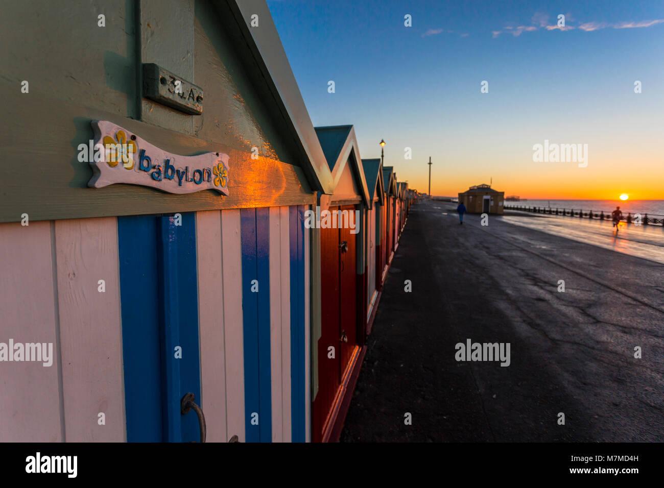 Brighton colorful beach hut beach house along the coast of Brighton Pier. - Stock Image