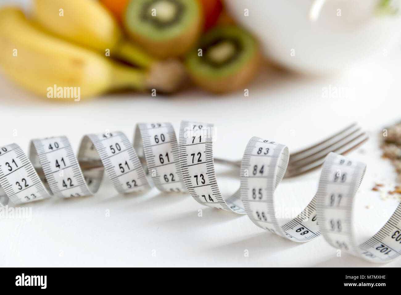 Healthy fruit,vegetables and measuring tape around the fork. Weight loss and right nutrition concept Stock Photo