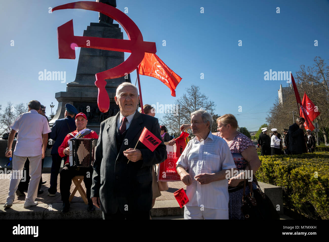 Participants in the May Day procession of the Communist Party are walking along Nakhimov square on the International - Stock Image