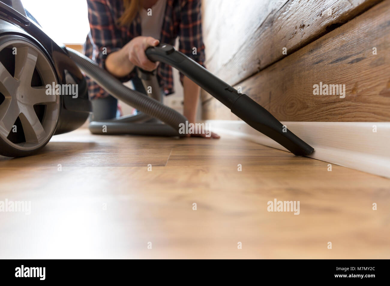 People, housework and housekeeping concept - happy woman with vacuum cleaner at home. Spring cleaning - Stock Image