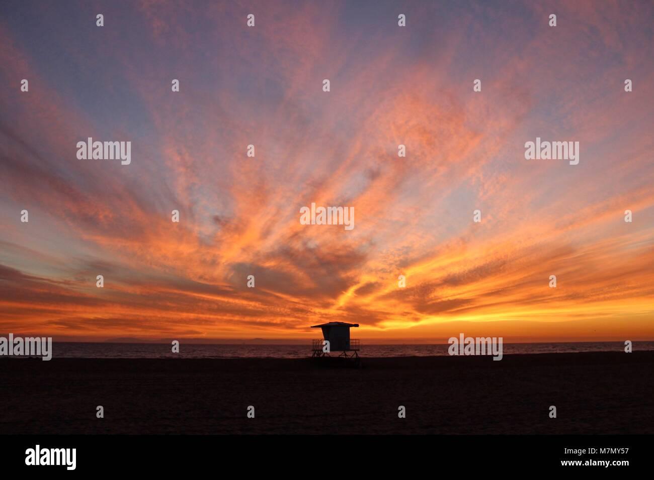Huntington Beach Sunset with lifeguard tower - Stock Image