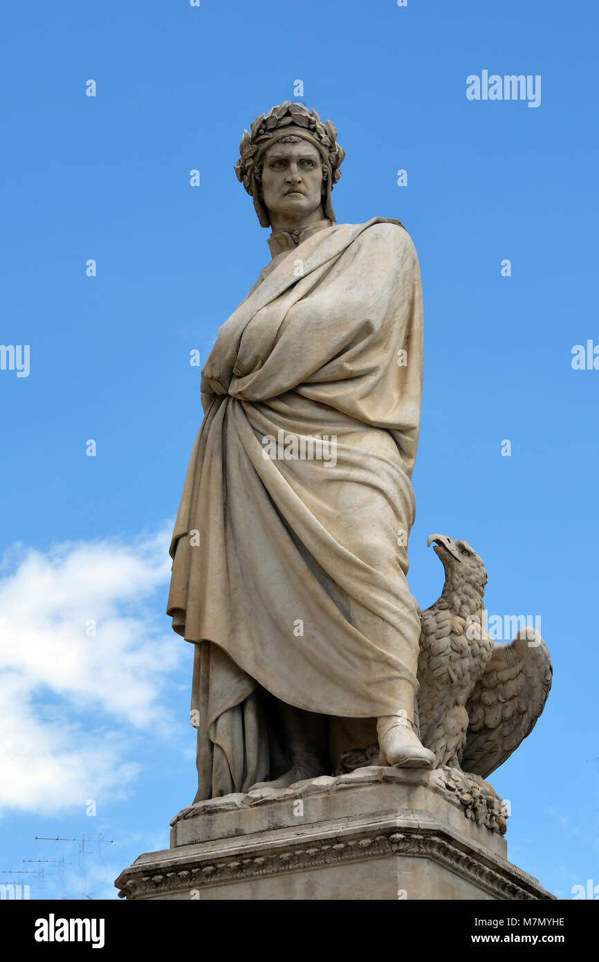Dante Alighieri monument on the Piazza Santa Croce next to the Basilica Santa Croce of Florence - Italy. - Stock Image