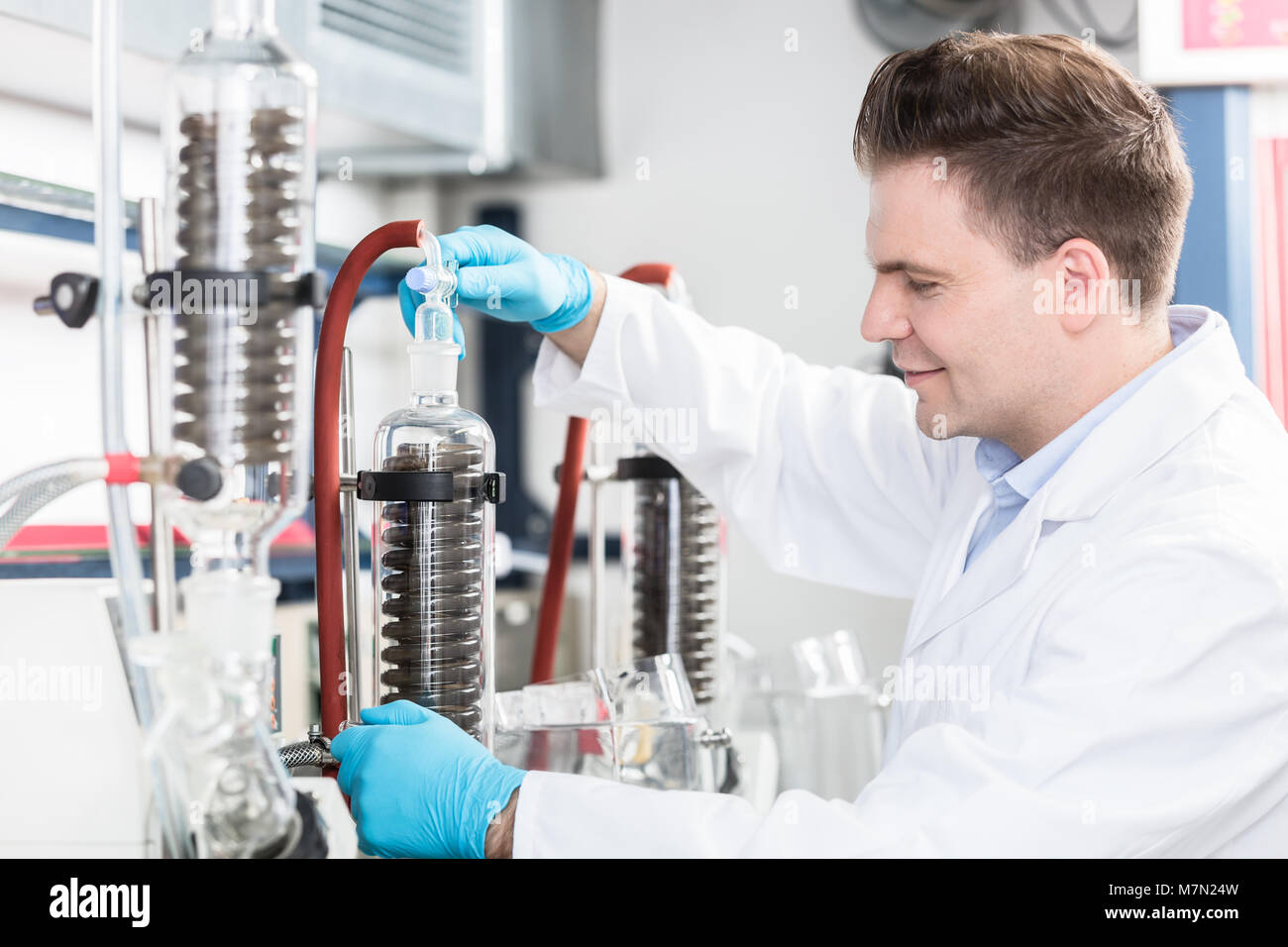 Scientist in research lab analyzing samples - Stock Image