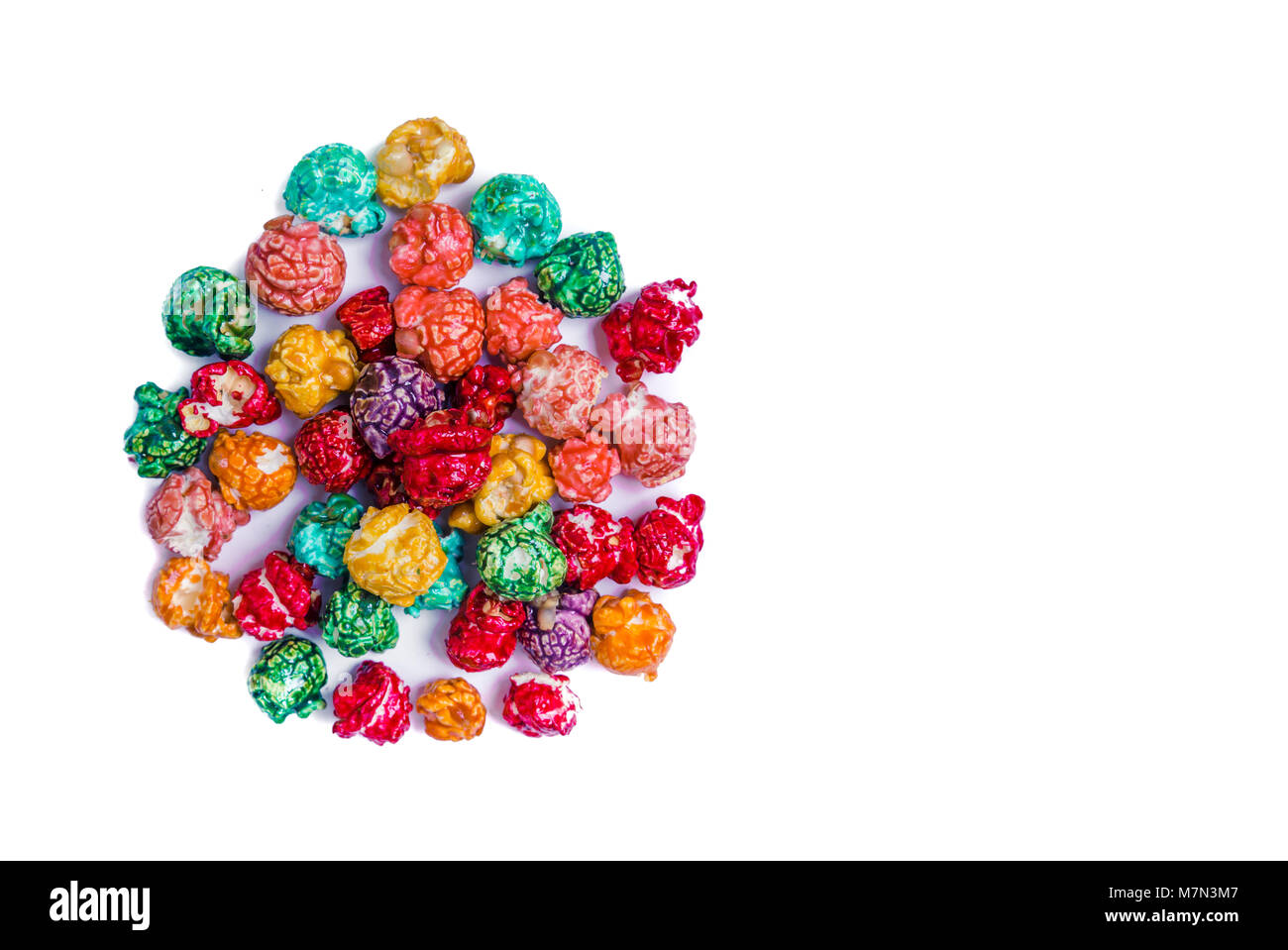 Brightly Colored Candied Popcorn, white background. Horizontal image of Junk food, fruit flavored popcorn. Colorful, - Stock Image