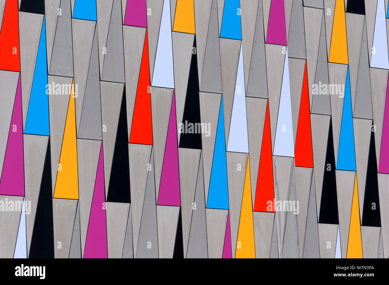 Colorful repeating triangles design on the exterior wall of a modern building in Richmond, BC, Canada - Stock Image