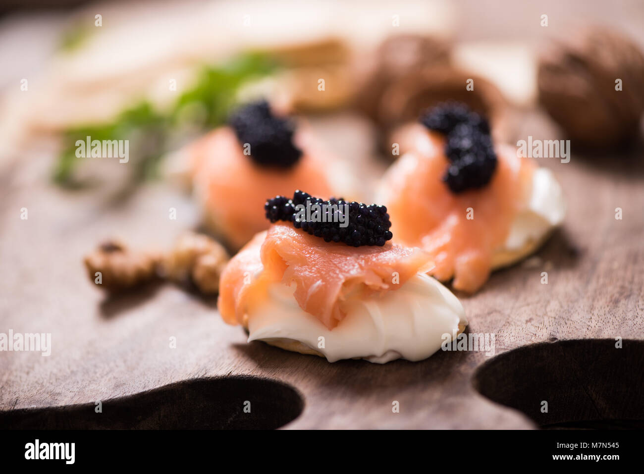 Canapes with smoked salmon and caviar - Stock Image