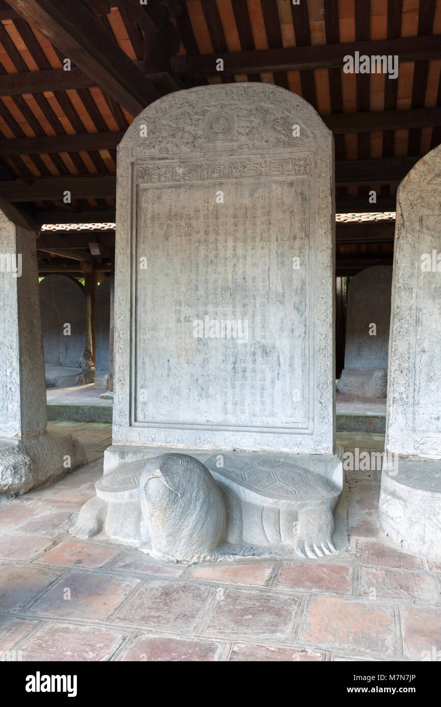 Turtle stone stelae bearing the names of exceptional scholars at the confucian temple of literature, Quoc Tu Giam, Stock Photo