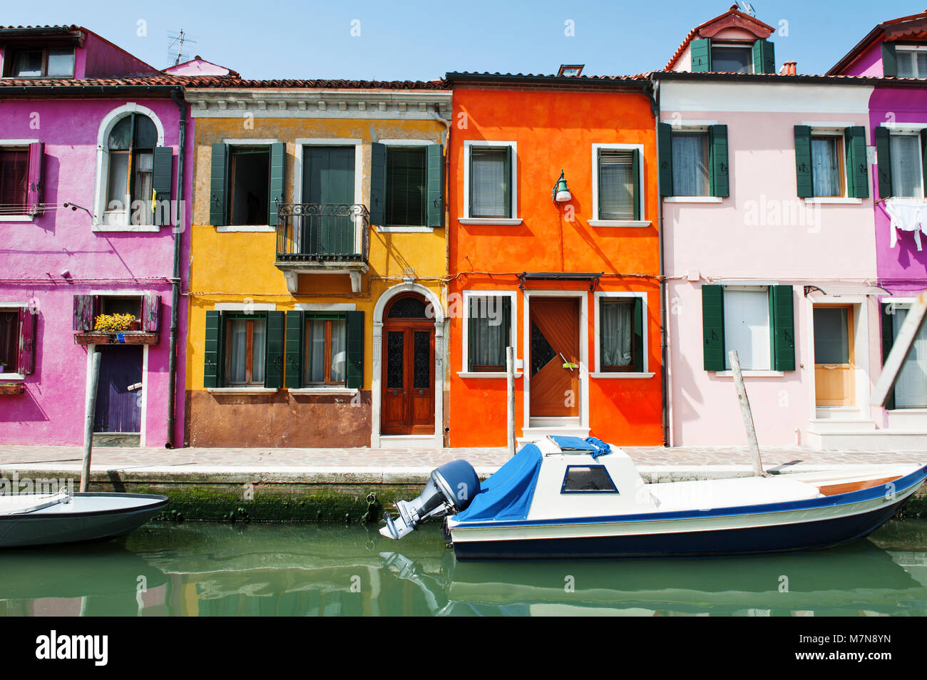 Venice, Burano island, Italy, Europe - scenic view of characteristic colorful buildings and the canal - Stock Image