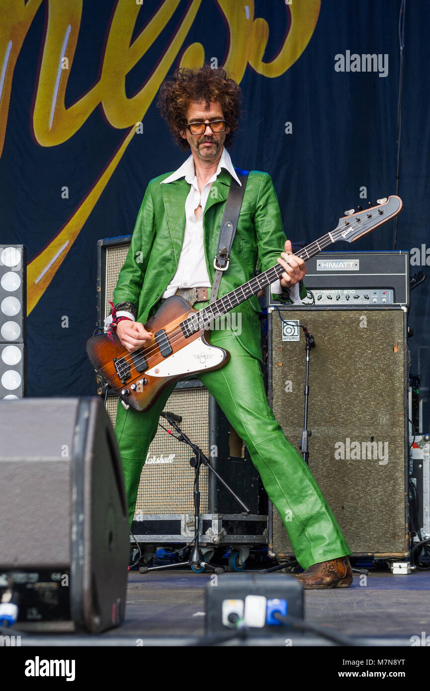 Frankie Poulain, bass player of The Darkness, on stage at Godiva Live Music Festival, Coventry, UK in July 2017. - Stock Image