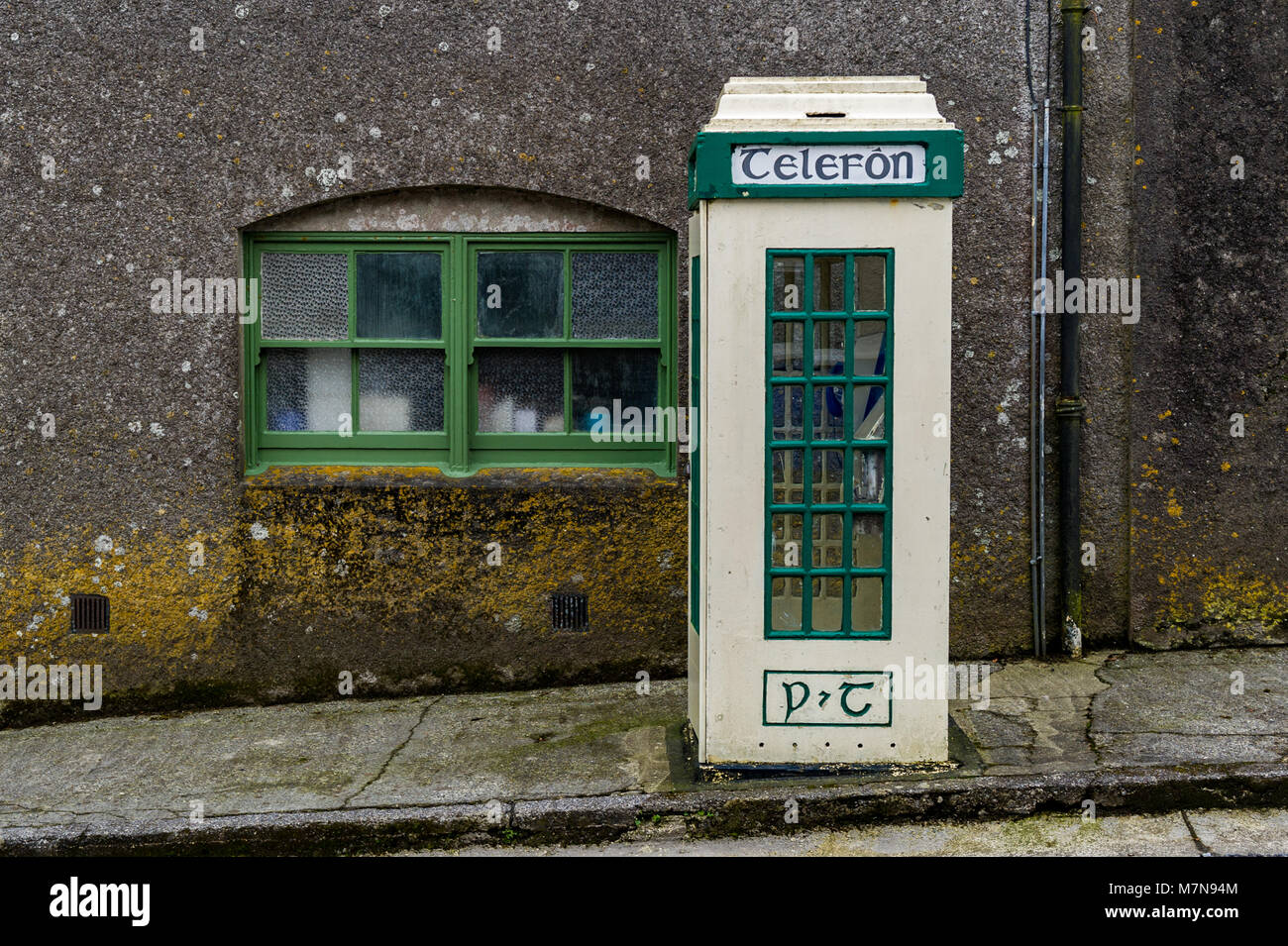 Old style Irish public telephone box telefon box in Castletownshend Village, West Cork, Ireland. - Stock Image