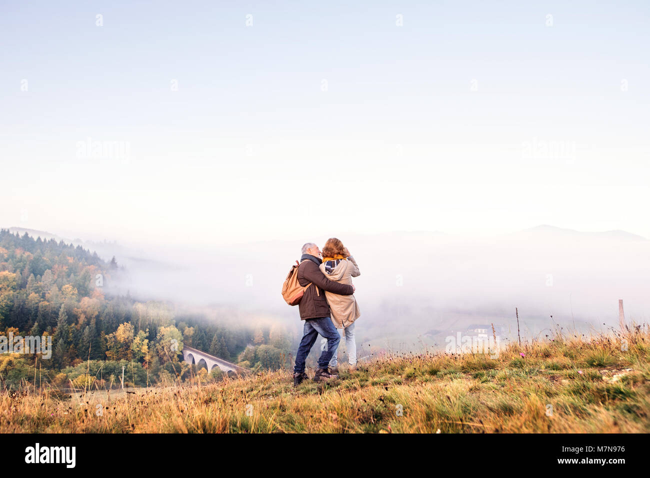 Senior couple on a walk in an autumn nature. - Stock Image