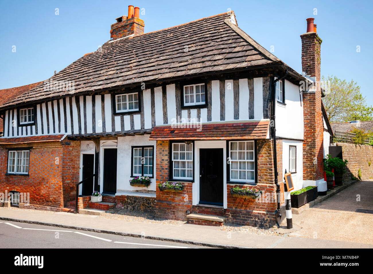 Traditional English Tudor style timber frame cottage with slate roof in Southern  England, UK - Stock Image
