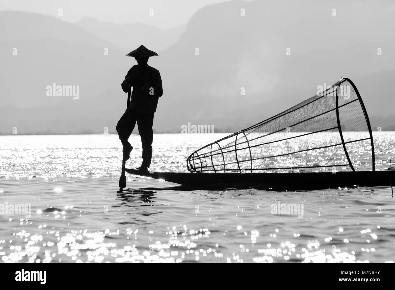Intha leg rowing fisherman at Inle Lake, Shan State, Myanmar (Burma), Asia in February - Stock Image