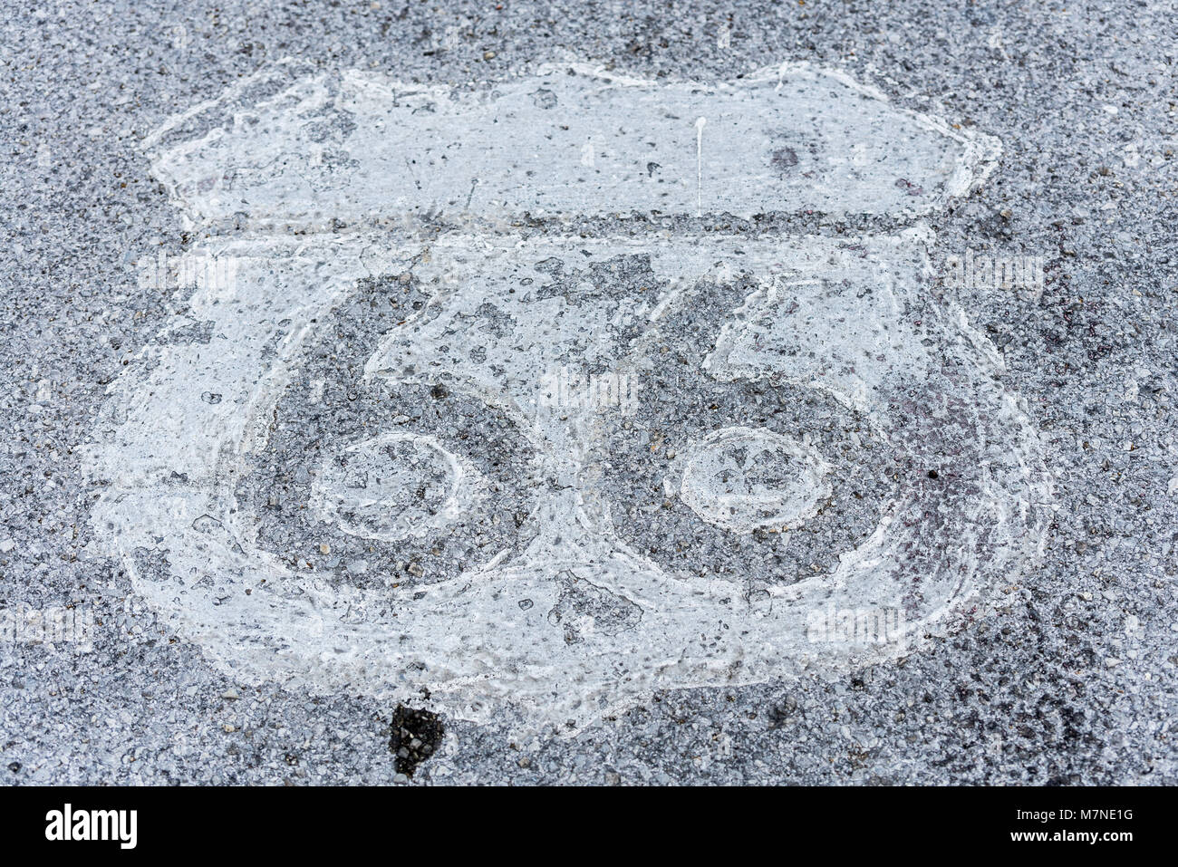 Route 66 pavement sign, worn out. - Stock Image
