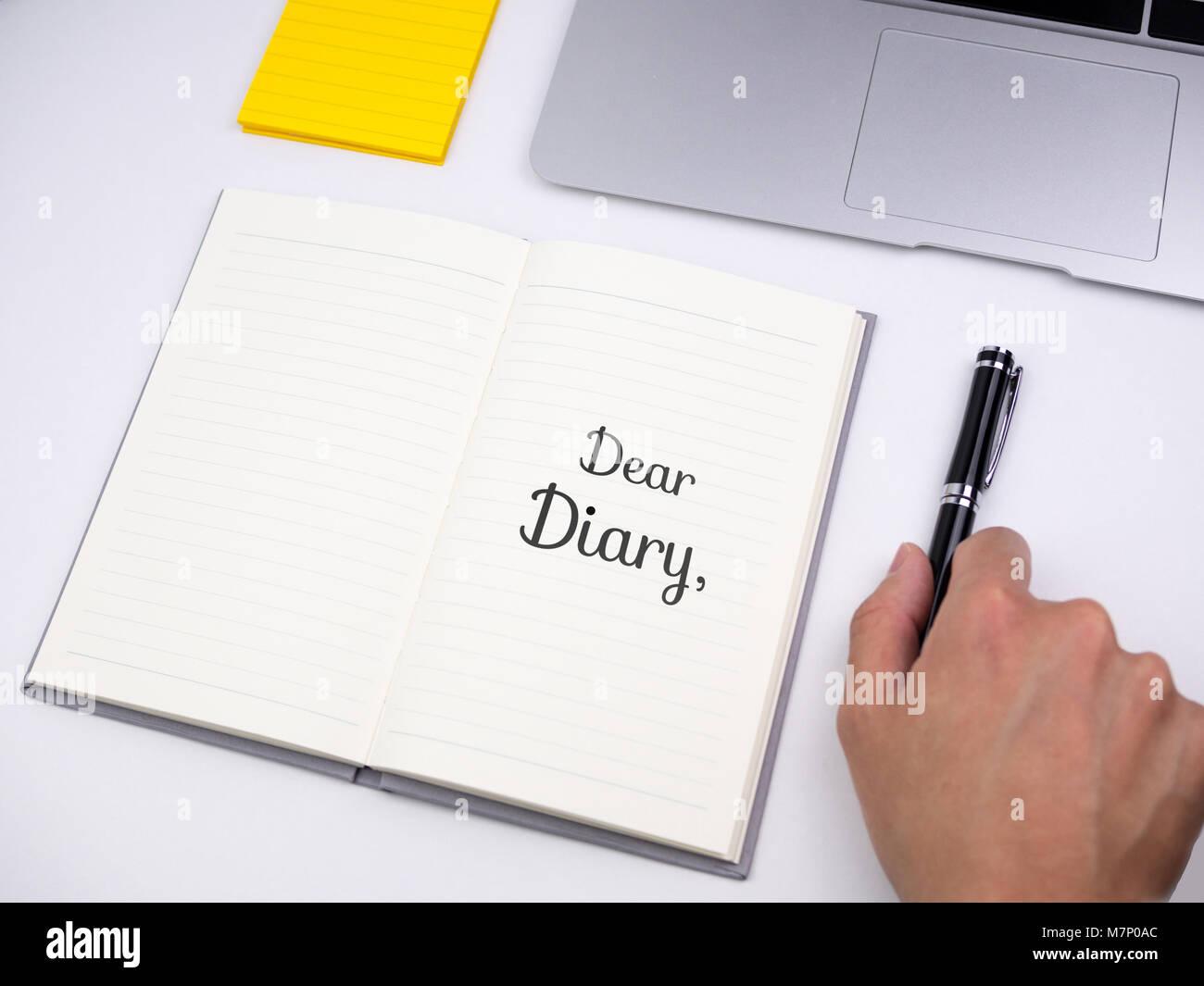 Dear diary written on notebook - Stock Image