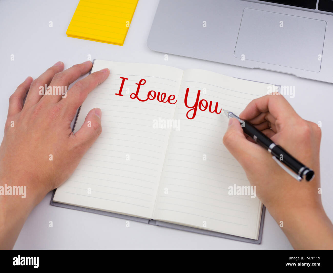 I love you written in note book on desk - Stock Image