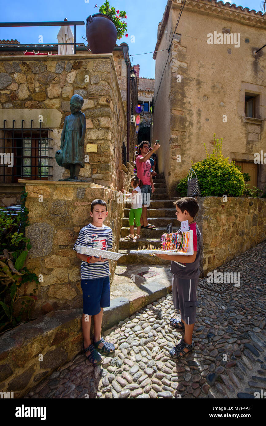 Kids Selling Souvenirs In Villa Vella Tossa De Mar Costa Brava Stock Photo Alamy