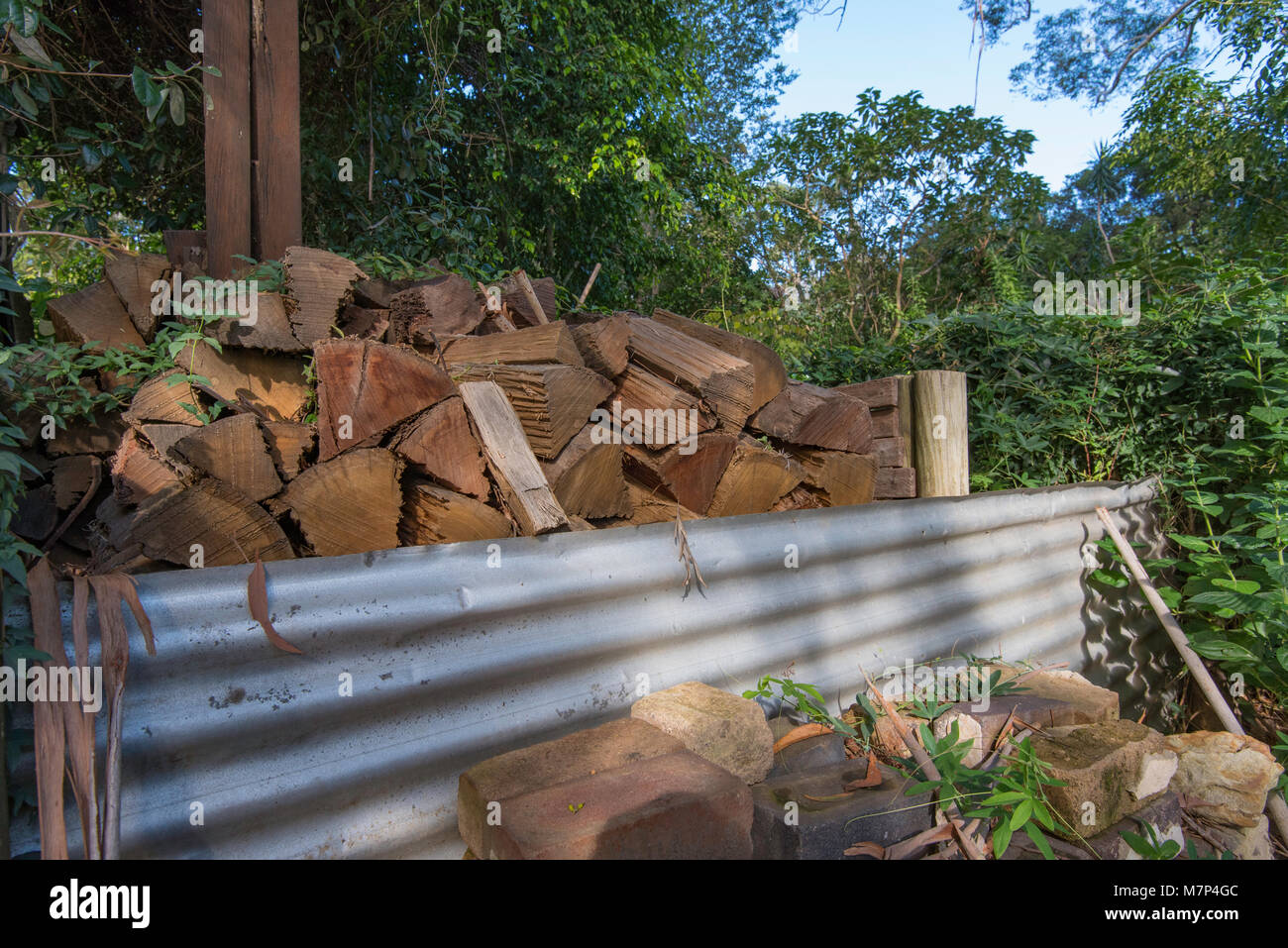 A stack of cut wood drying for use in a home fireplace in Sydney, Australia - Stock Image