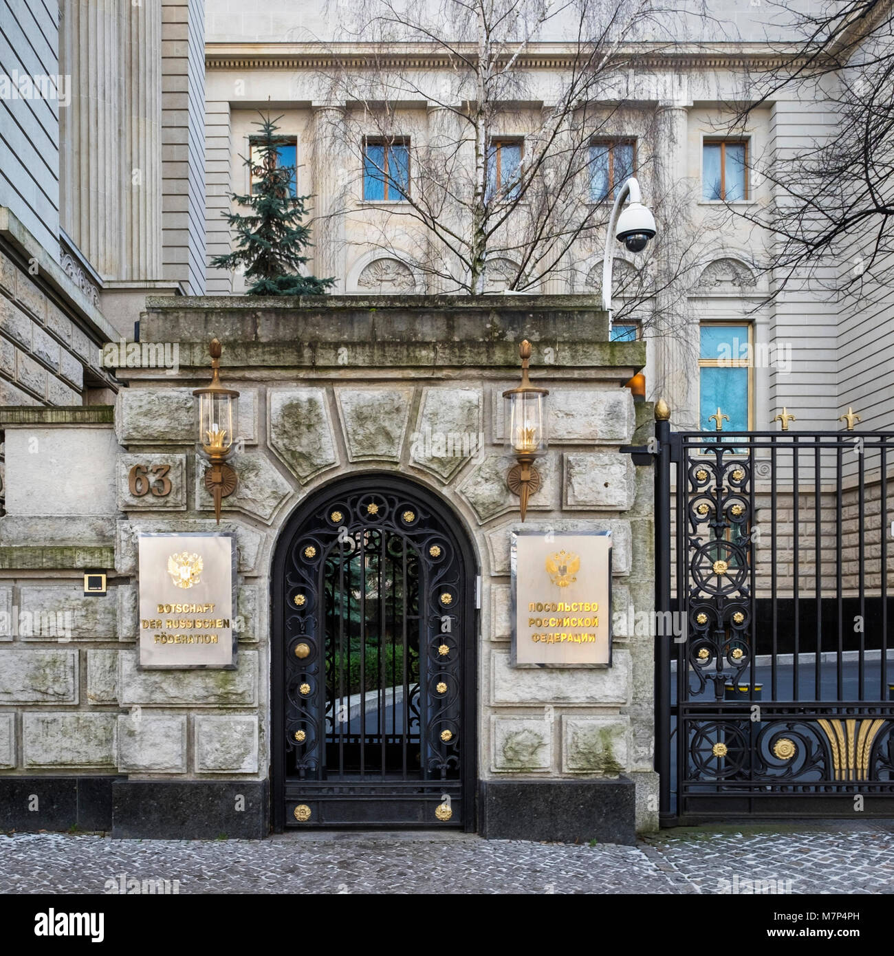 Berlin-Mitte,Unter den Linden, Embassy of the Russian Federation. Building entrance with ornate gate and lamps - Stock Image