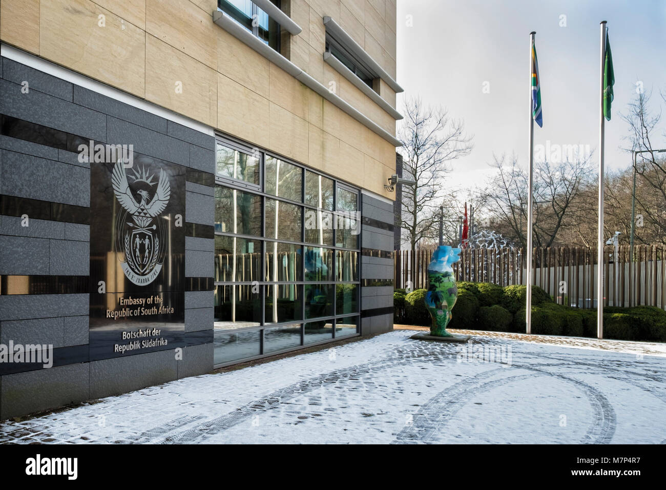Berlin Mitte,Embassy of the Republic of South Africa. Building exterior, Coat of arms, flags,Buddy bear & snow - Stock Image