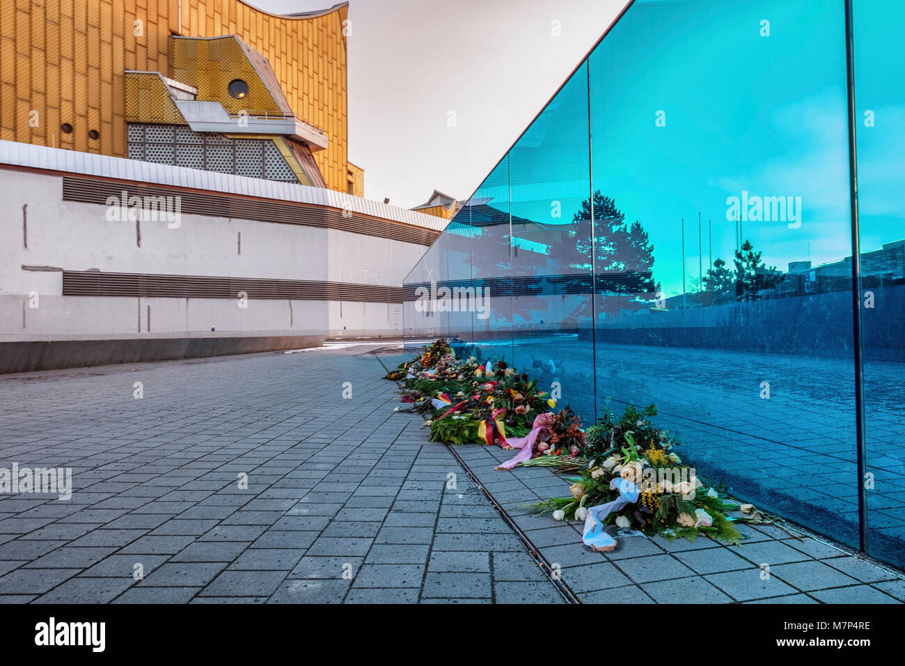 Berlin, Mitte. Blue glass wall Memorial in front of Berlin Philharmonic Concert hall. Monument to disabled victims - Stock Image