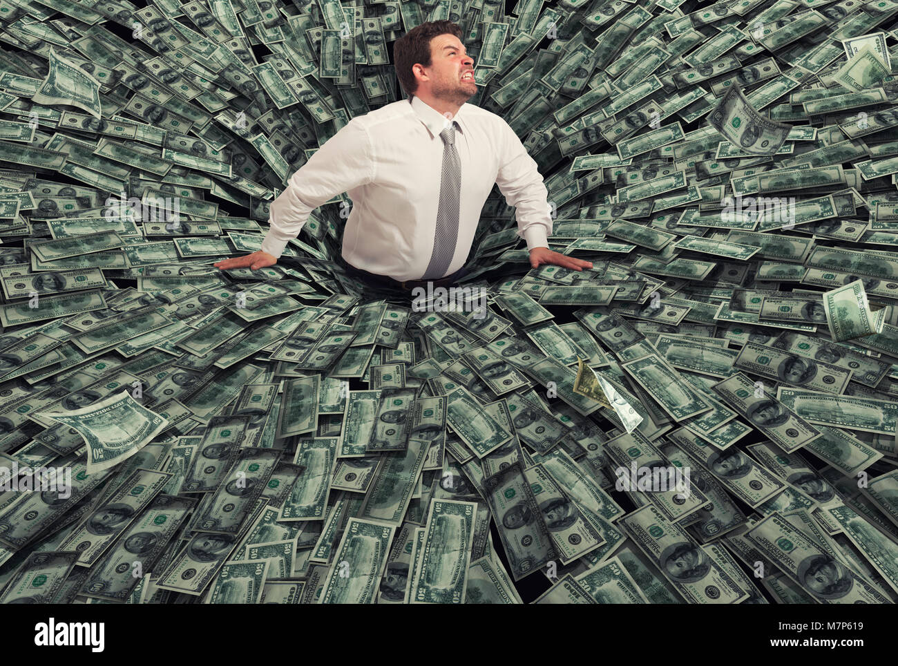 Businessman swallowed by a black hole of money. Concept of failure and economic crisis - Stock Image