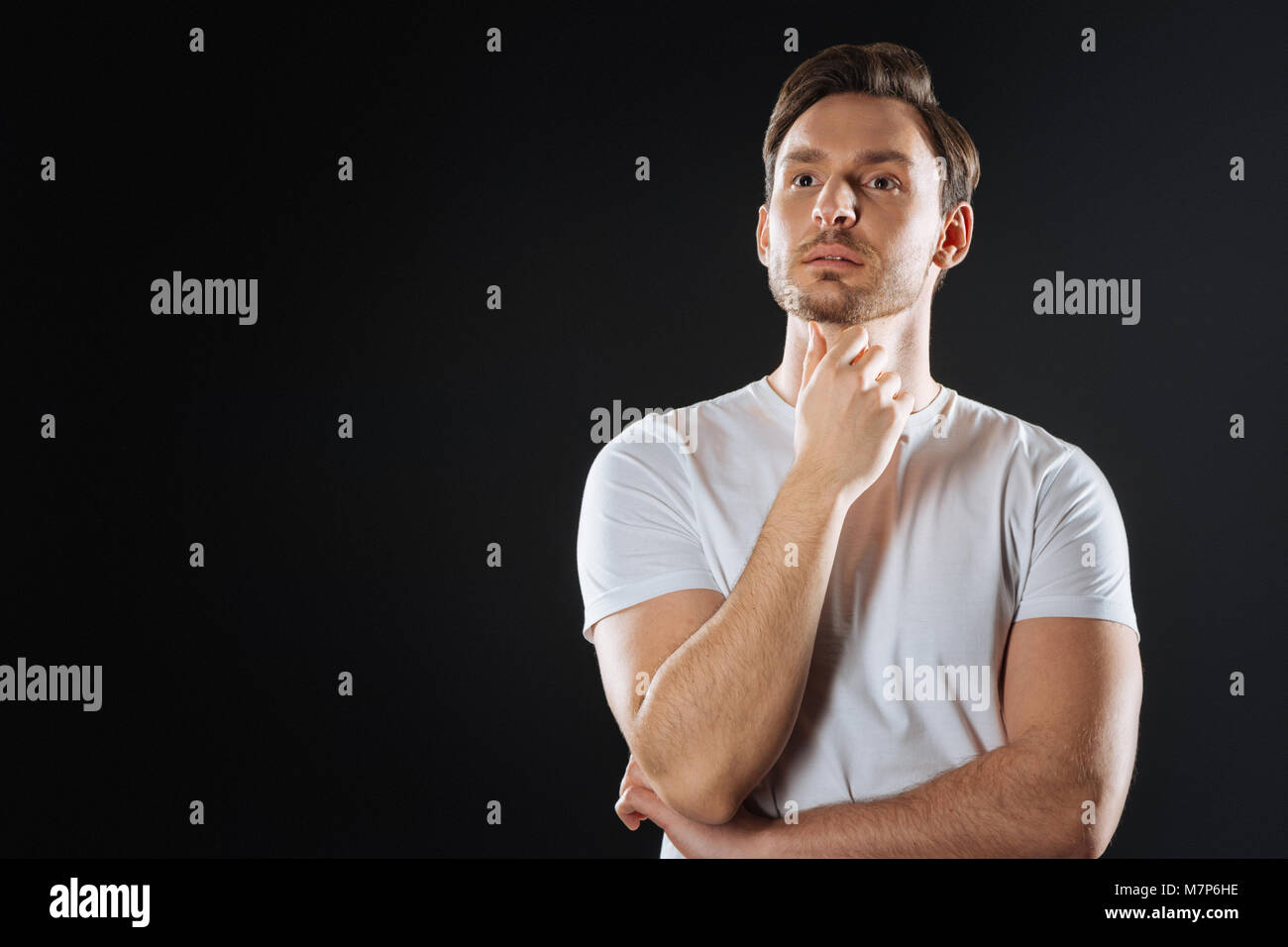 Deep clever man standing and thinking. - Stock Image