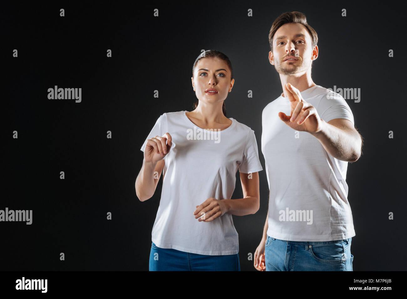 Creative pleasant couple imagining and communicating. - Stock Image
