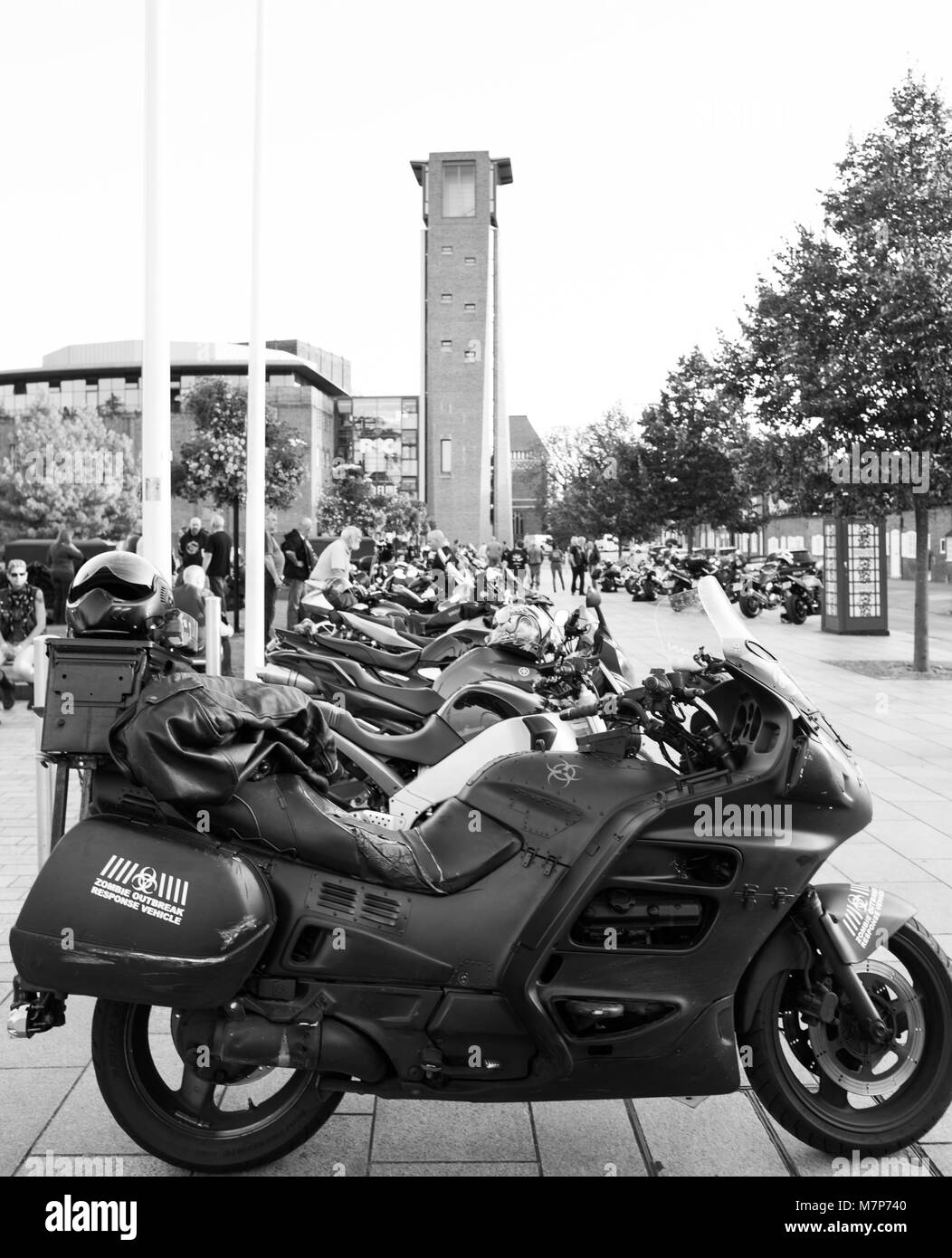 black and white long row of parked motorbikes outside the Royal Shakespeare Theatre in Stratford upon Avon - Stock Image