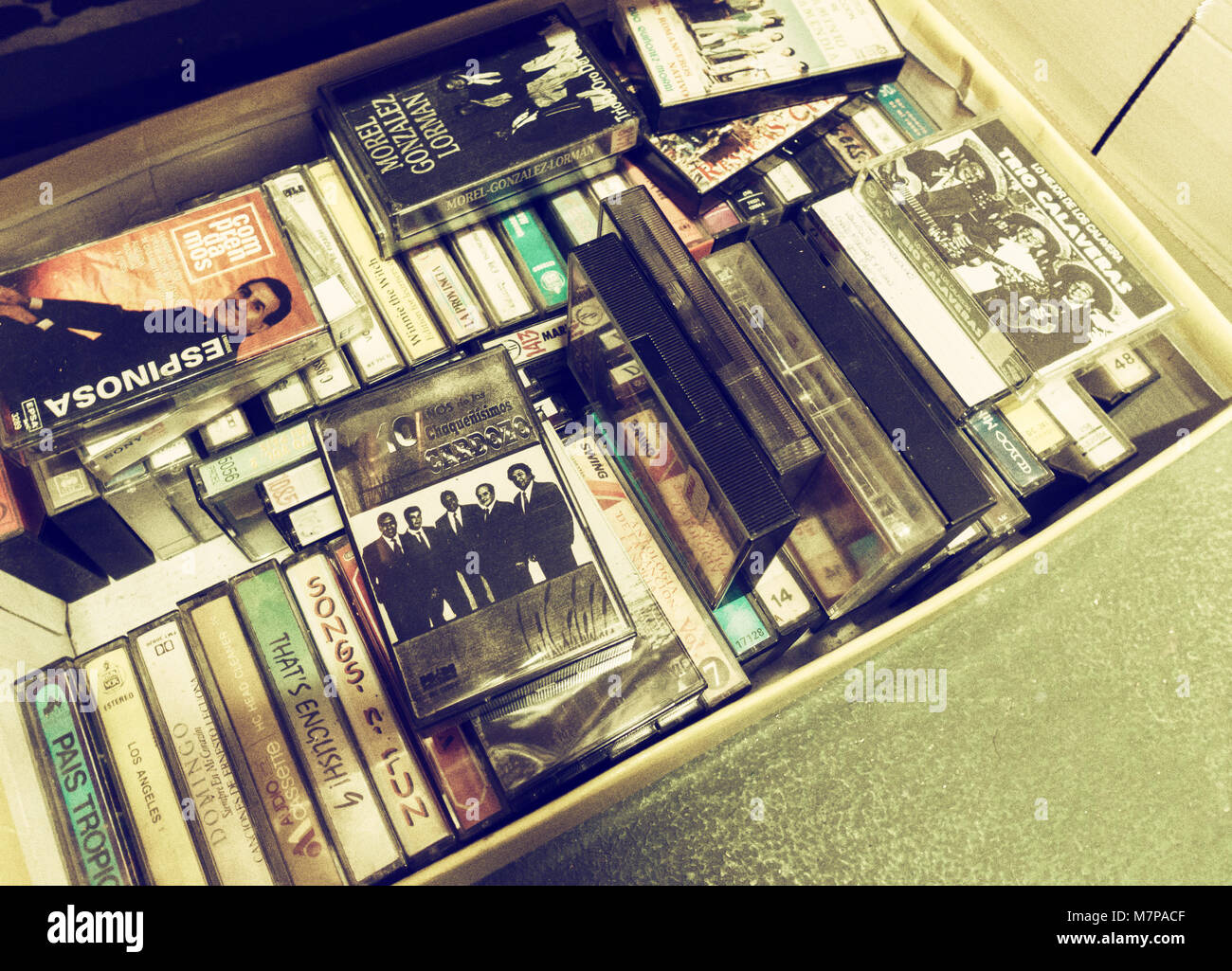 Box of cassette tapes in charity shop in Spain - Stock Image
