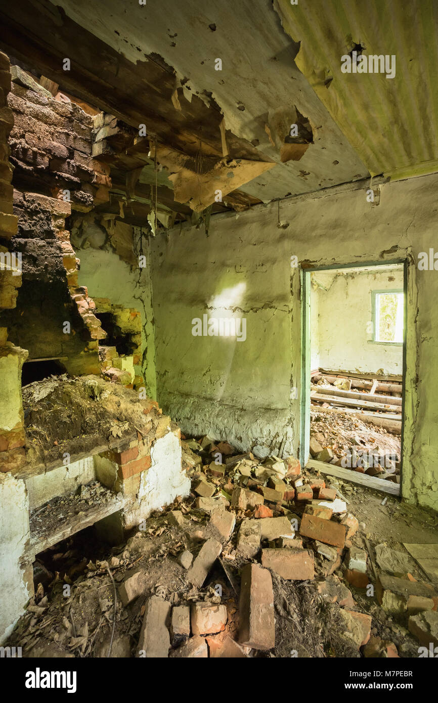 The Ruined Brick Oven Furnace In Abandoned Destroyed Country House In The Zone Of Nuclear Contamination After Chernobyl - Stock Image