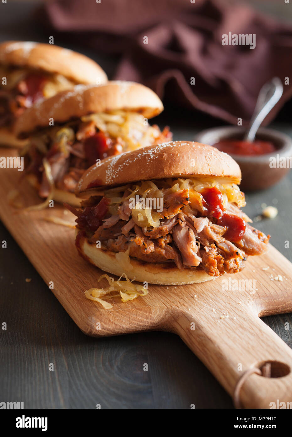 homemade pulled pork burger with caramelized onion and bbq sauce - Stock Image