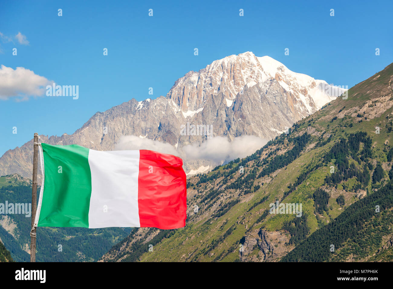 Italian flag, Monte Bianco (Mont Blanc) in the background view from Aosta Valley, Italy - Stock Image