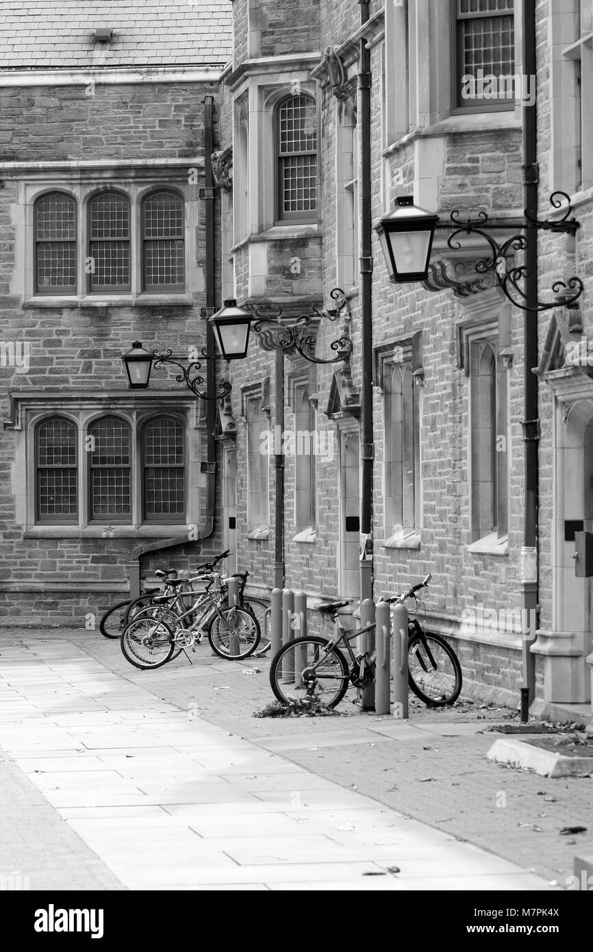 Some bicycles parked outside a building - Stock Image