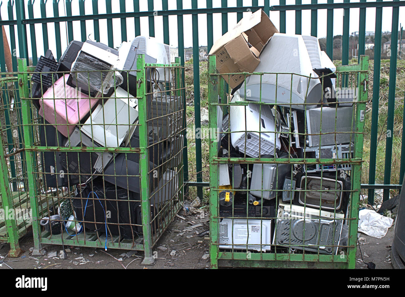 cage of redundant computer screens in a local dump in west cork, ireland - Stock Image
