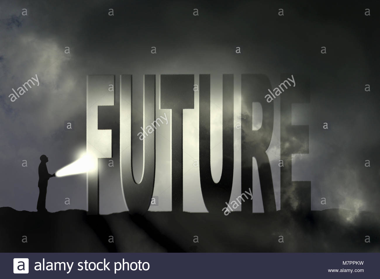 Man shining flashlight on the word future - Stock Image