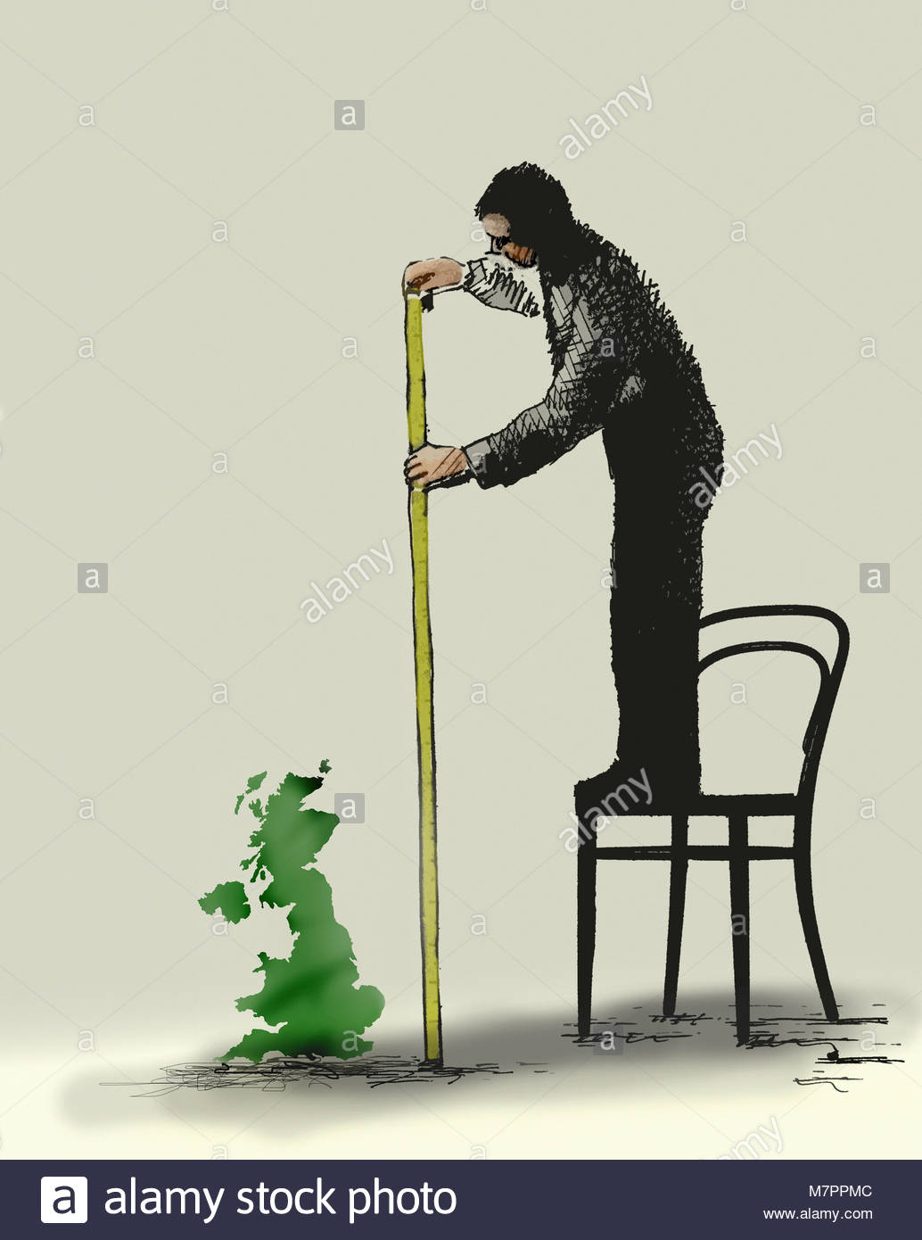 Man standing on chair measuring size of small United Kingdom - Stock Image