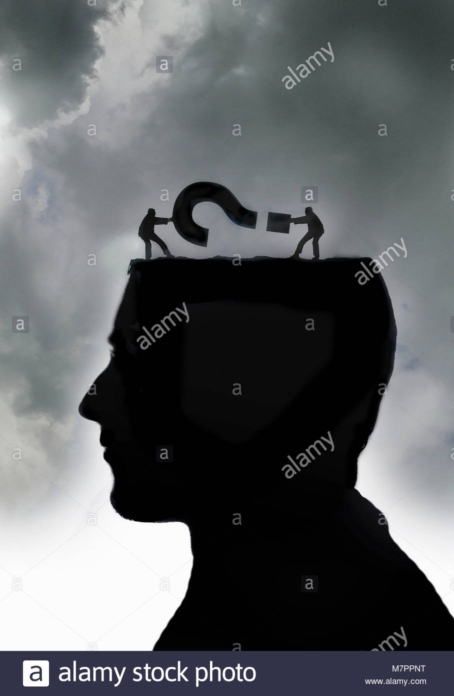 Man struggling with question mark inside of head - Stock Image
