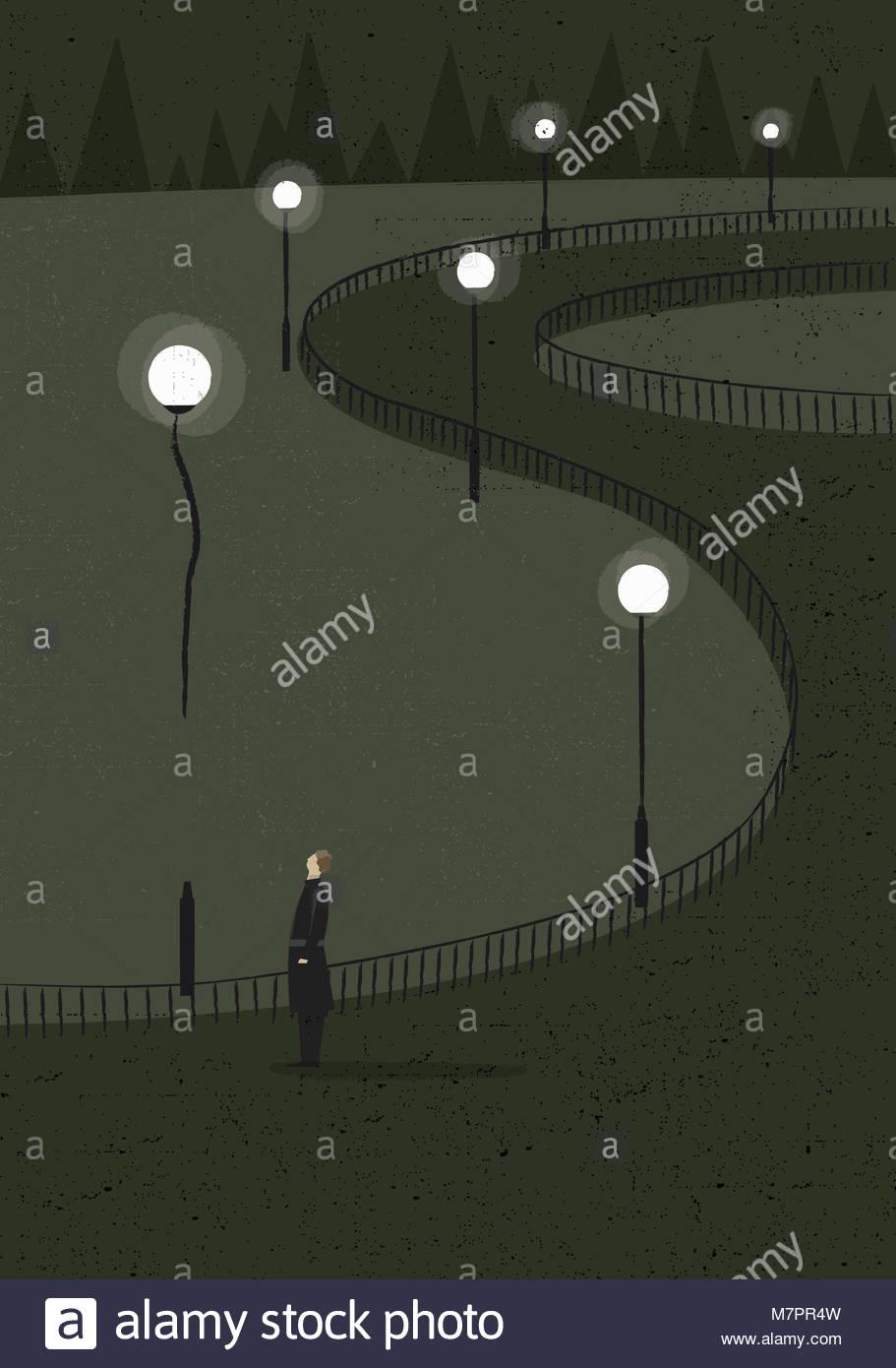Man watching street light rising as balloon - Stock Image