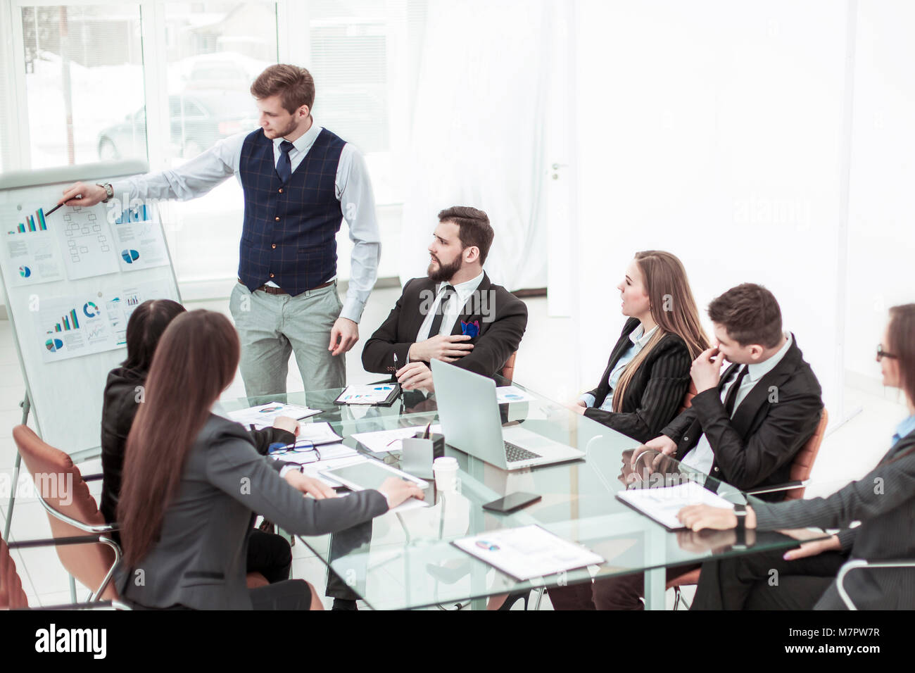business team discussing the presentation of a new financial project on a workplace at office - Stock Image