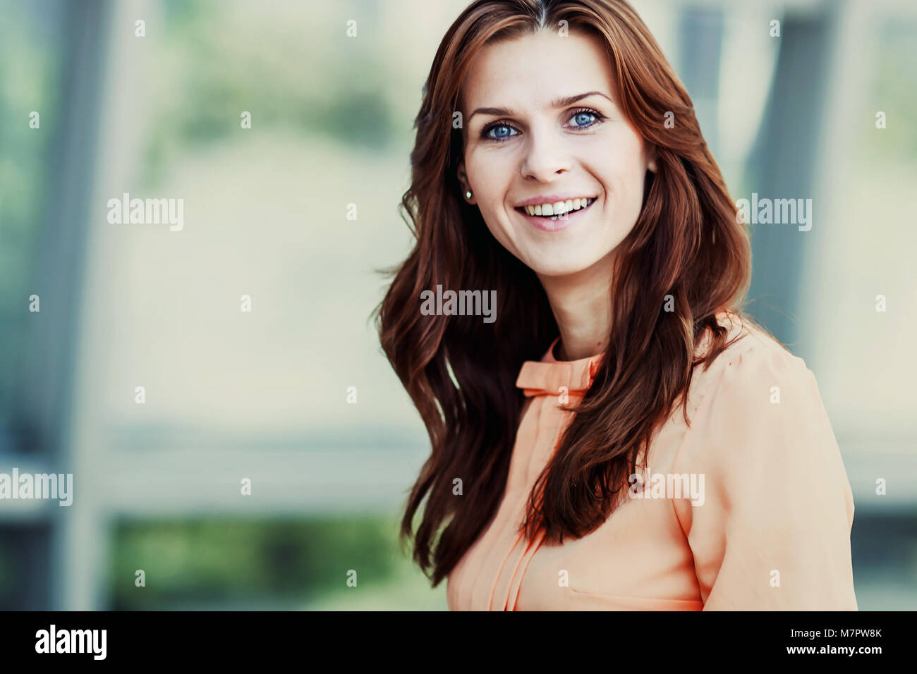 portrait of successful business woman on the background of the spacious office - Stock Image