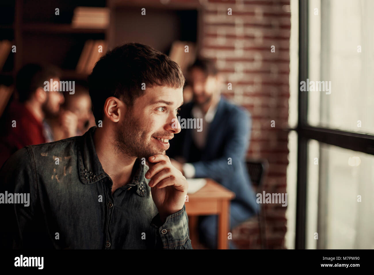 portrait of an employee of the company on the background of business team - Stock Image