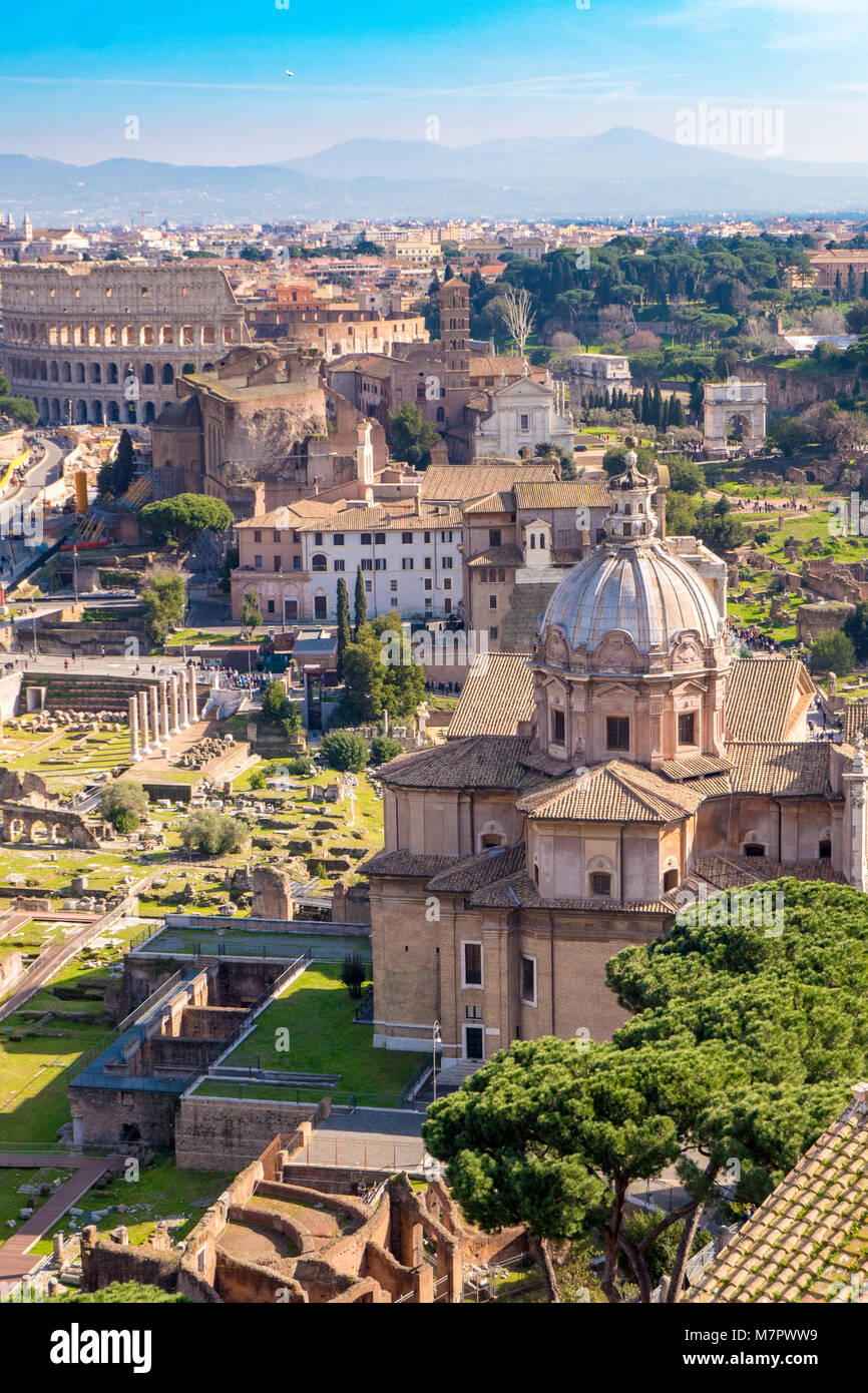 Aerial view of the Roman Forum and Colosseum in Rome, Italy. Rome from above. - Stock Image