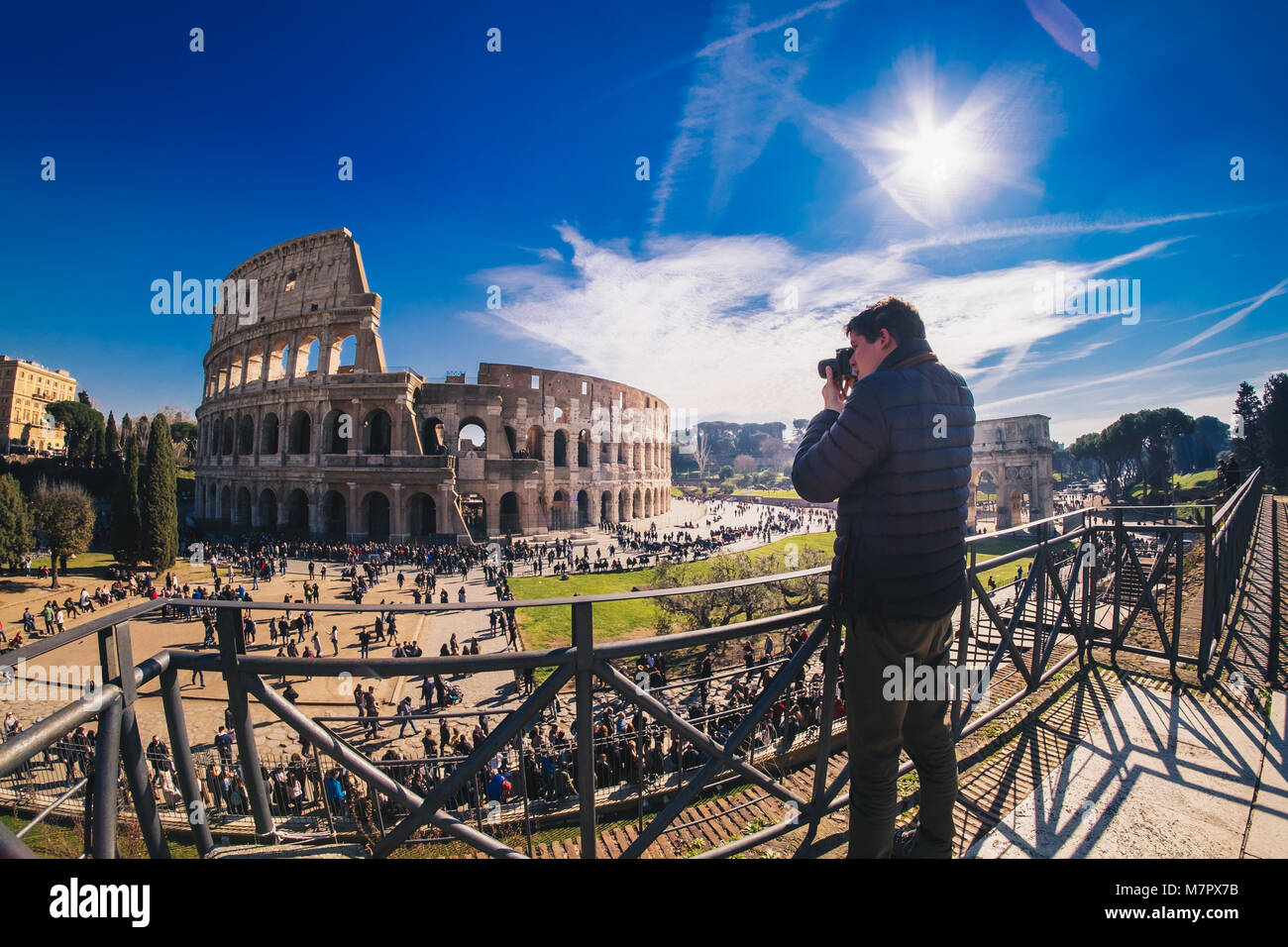 Tourist taking pictures at the Colosseum in Rome, Italy - Stock Image
