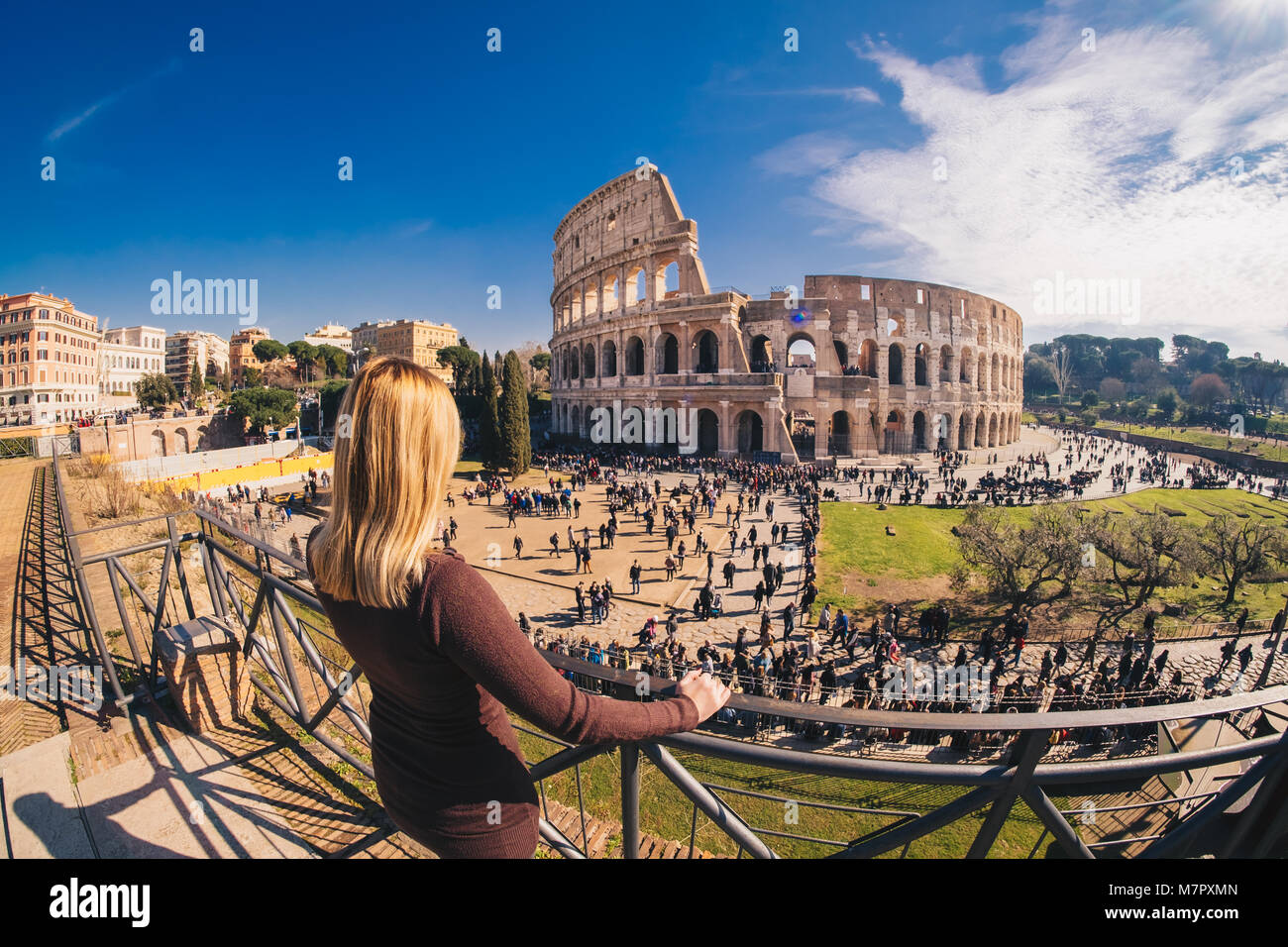 Woman tourist enjoying the view of the Roman Colosseum in Rome, Italy Stock Photo