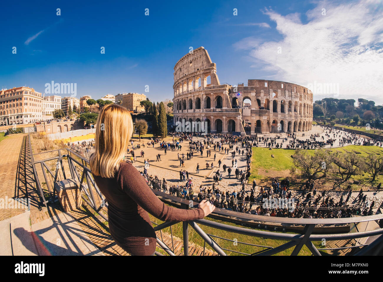 Female traveler watching over the Colosseum in Rome, Italy - Stock Image
