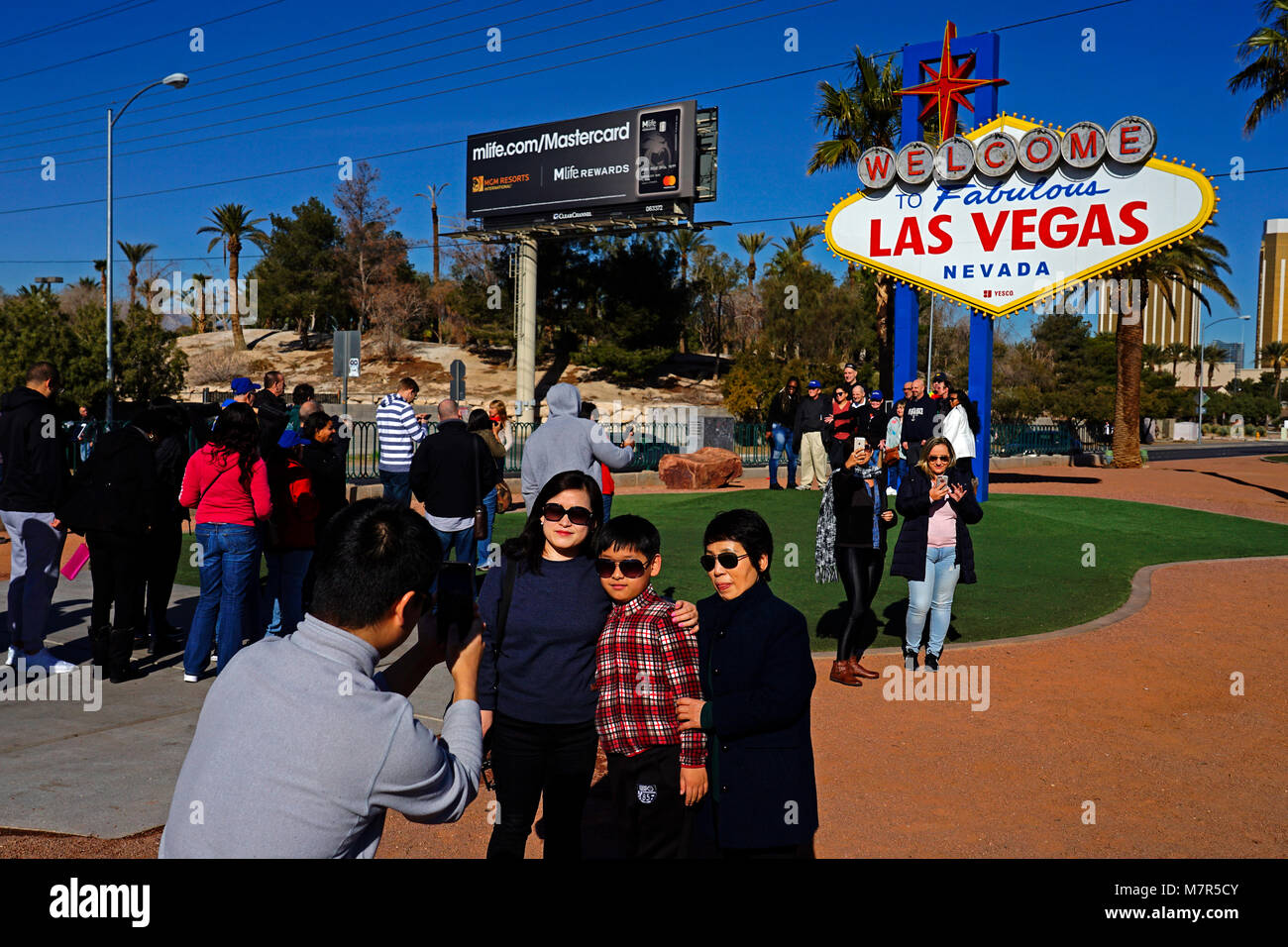 Tourists having photograph next to Famous Sign welcome to Las Vegas,Nevada,USA Stock Photo