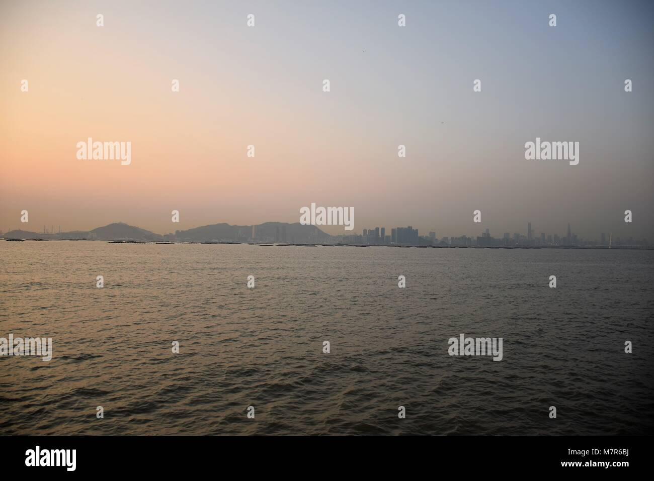 Sunset in Shenzhen bay seen from New Territories, Hong Kong Stock Photo