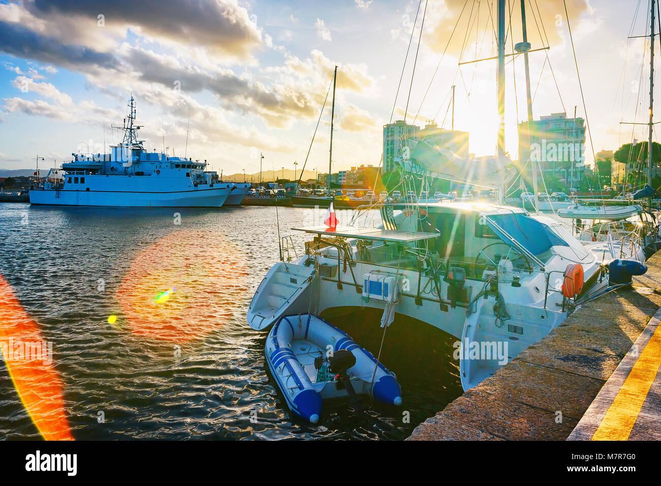 Sunset at Harbor with Luxury ships in Olbia, Sardinia, Italy - Stock Image