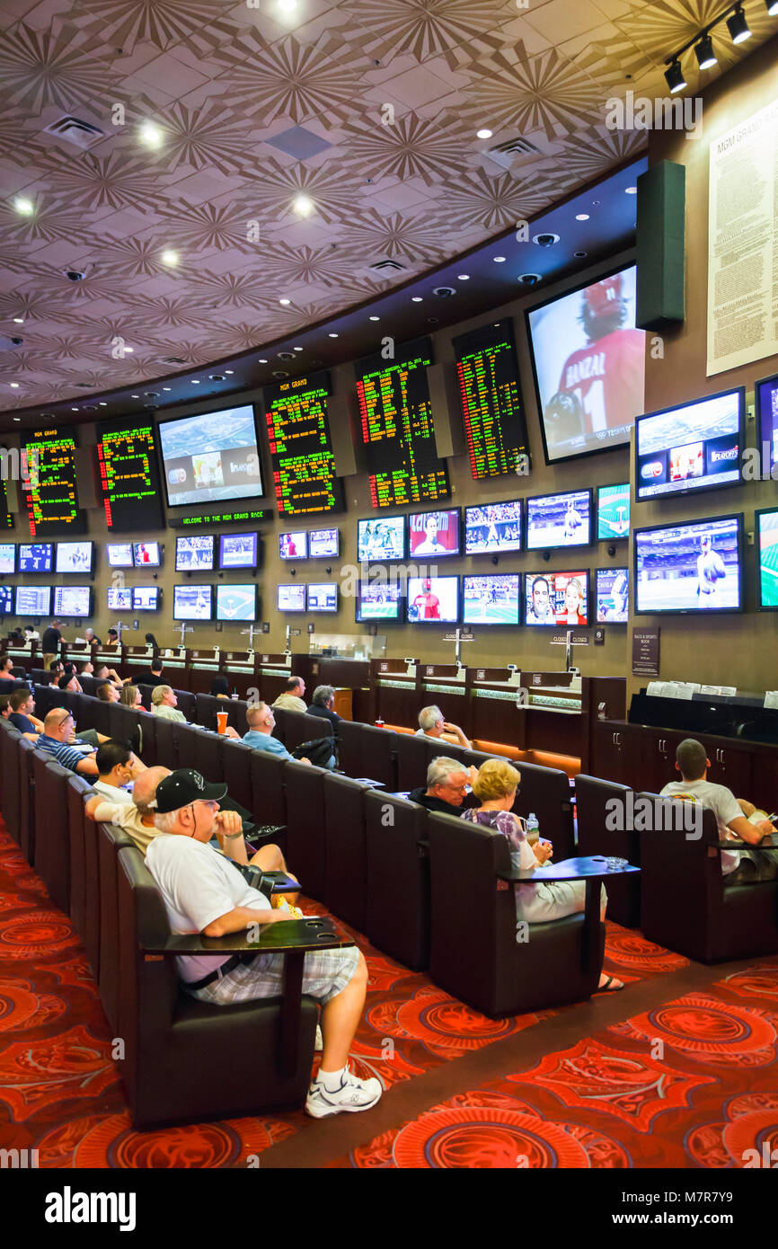 Las Vegas, USA - May 16, 2012. Tourists watch sports on TV screens in a casino in MGM Grand Hotel. - Stock Image